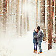 Young Couple Embracing In Winter Forest. Winter Vacations. Weekend Getaway. Space For Text. Natural Colors, Selective Focus. Instagram Color Effect stock photo