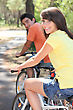 Young Couple Enjoying Bike Ride Together