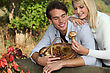 Young Couple Gathering Mushrooms stock photo