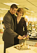 Young Couple Gift Shopping stock photo