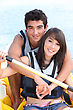 Young Couple In A Paddle Boat stock image