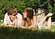 Young Couple Laying in Grass stock photography