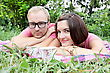 Young Couple Man And Woman Laying On Picnic stock photography