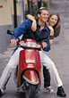 Young Couple on Motor Scooter stock image