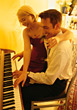 Young Couple Playing Piano stock photography