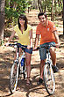 Biking Young Couple Riding Bikes In A Forest stock image