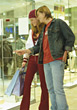 Young Couple Shopping At Mall stock photography