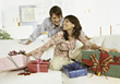 Noel Young Couple with Christmas Presents stock photo