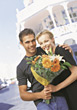 Young Couple with Flower Boquet stock photography