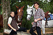 Young Couple With Two Horses stock photo