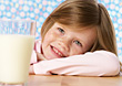 Young Girl and Glass of Milk stock photography