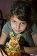 People Eating  Young Girl Eating Pizza stock photography