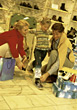 Young Girl & Parents Trying On Shoes At Mall stock photo