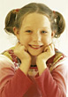 Young Girl with Pigtails stock photo