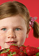 Young Girl With Strawberries stock photo