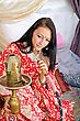 Asian Young Indian Girl In Traditional Red Clothing With Hookah stock photo