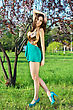 Young Leggy Brunette In Short Sexy Dress Posing Near The Tree stock photo