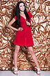 Young Leggy Brunette Wearing Red Dress Posing On Golden Background stock photo