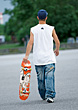 Young Man Holding Skateboard