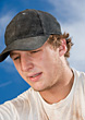 Young Man In Cap Sweating stock photo