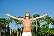 Yoga Young Man Spreading Hands On A Sky Backgroung stock photo