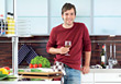 Young Man With Wine Glass In Kitchen stock image