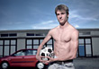 Young Man with Soccer Ball stock photography