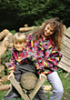Young Mother with Son Outdoors stock image