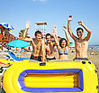 Young People With Boat On The Beach stock photo