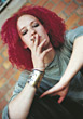 Young Red Headed Teen Smoking stock photography