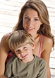 Outside Young Woman & Boy Sitting On The Dock stock photography