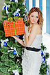 Young Woman With A Christmas Present In The Orange Box stock photo