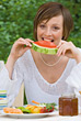 Young Woman Eating Watermelon stock photo