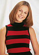 Young Woman In Red & Black Sweater stock image