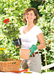 Young Woman Potting Plants stock photo
