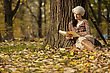 Young woman reading a book in the forest stock image