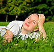 Young Woman Relaxing On The Grass In Park stock photography
