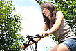 Young Woman Riding Bicycle stock image