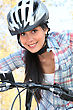 Young Woman Riding Bike In The Park stock image
