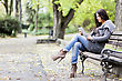 Young woman with tablet on the bench in the park stock photo