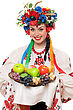 Young Woman In The Ukrainian National Clothes With Fruit. stock photo