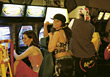Young Women At Videogame Arcade stock image