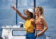 Young Women on a Sailboat stock photography