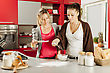 Young women preparing meal in the kitchen stock image