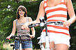 Young Women Riding Bikes stock image