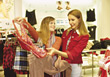 Young Women Shopping For Clothes stock image
