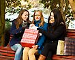 Young Women Undoing Their Christmas Presents stock photo