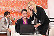Young Women Using A Laptop In A Restaurant stock photo